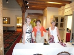Lucille, Carolyn and Trudy decorating the registration table.